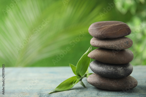 Garden Poster Spa Composition with stones on table against blurred background. Zen concept
