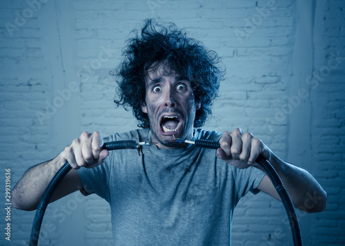 Fotografia, Obraz  Funny image of man getting electric shock with funny face and smoke all around