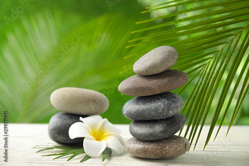Composition with stones on table against blurred background Canvas Print