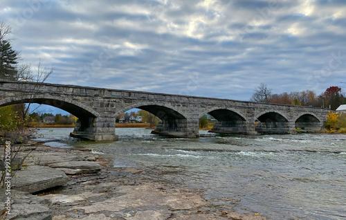 Pakenham Bridge, a five span stone bridge that crosses the Mississippi River on a cloudy autumn day in Pakenham, Canada