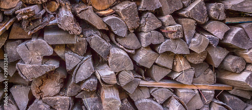 Spoed Foto op Canvas Brandhout textuur stack of firewood stacked for a stove and a fireplace near the house in rustic rustic style background with space for text