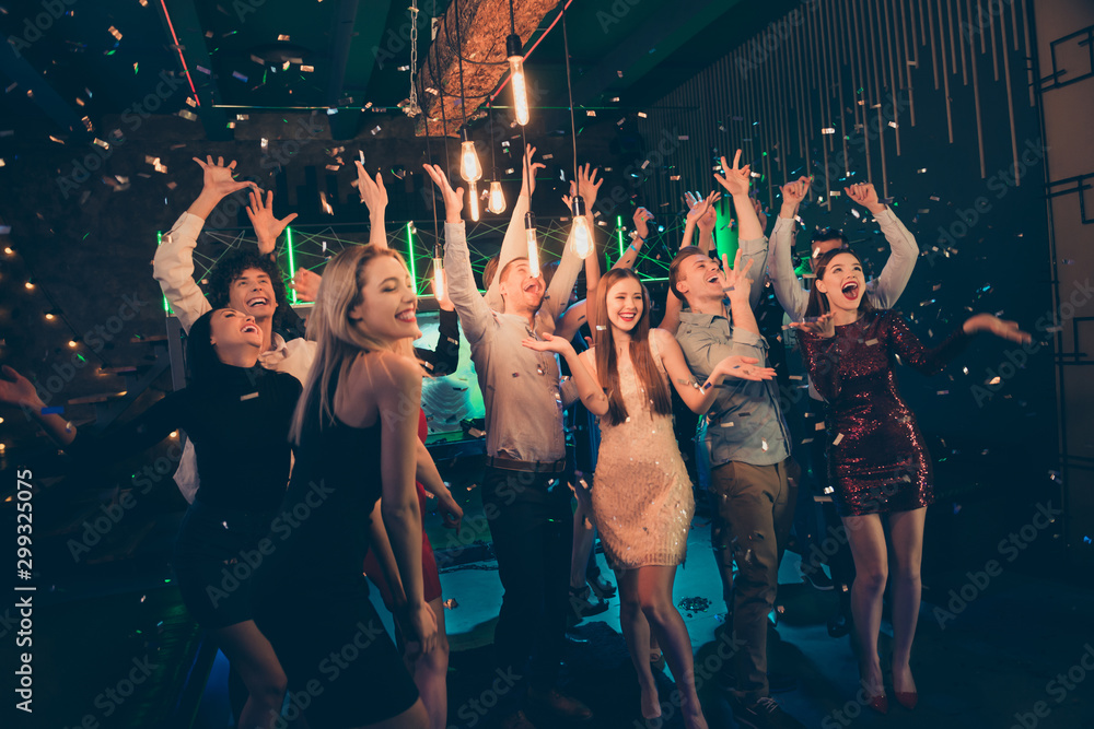 Fototapety, obrazy: Photo of screaming cheerful excited ecstatic beautiful company dressed in formalwear chilling out at night club catching confetti with smiles on their faces