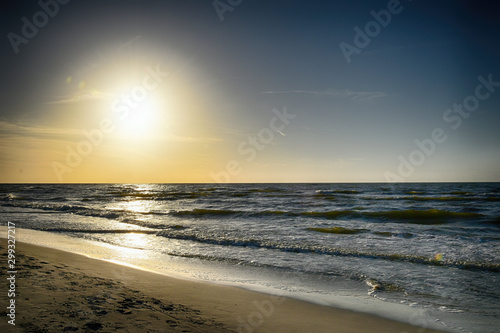 orange sunset on the beach of the Baltic Sea in Poland Canvas Print