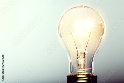 Fotografiet Glowing yellow light bulb, busienss idea concept