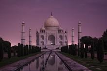 Beautiful Shot Of Taj Mahal Surrounded By Beautiful Green Trees Under The Breathtaking Purple Sky