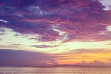 Dramatic  Beach Sunset With Blue Sea And Purple Cloud   Yellow Sky Background,Samui Island,Thailand