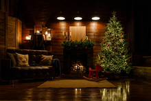 Christmas And New Year Interior: Fireplace, Lamps, Green Christmas Tree, Brown Leather Sofa, Gifts, Candles, Moose Rocking Chair.  Lots Of Lights Glowing In The Dark.
