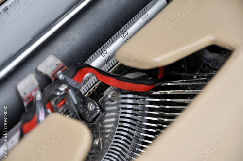 A blurred close up of a vintage typewriter, its keys, ribbon and cylinder clearly identifiable, symbolizes writing, journalism and communication in the abstract Canvas-taulu