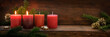 canvas print picture - Second Sunday in Advent, four red candles, two of them are burning, fir branches and Christmas decoration on dark rustic wood, wide panoramic format with copy space