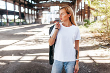 Girl Wearing White T-shirt, Glasses And Leather Jacket Posing Against Street , Urban Clothing Style. Street Photography