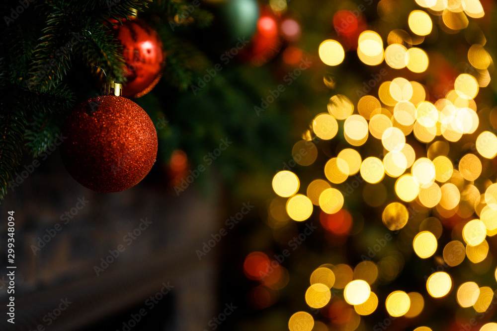 Fototapety, obrazy: Christmas and New Year interior - blur background: fireplace, lamps, green Christmas tree, brown leather sofa, gifts, candles, moose rocking chair.  Lots of lights glowing in the dark.