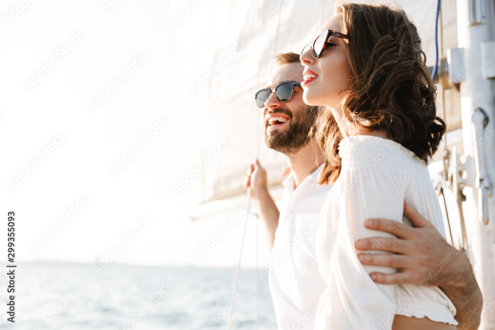 Fototapety, obrazy: Optimistic cheery young loving couple outdoors