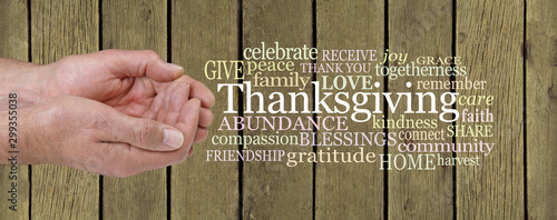 Generosity at Thanksgiving Word Cloud - Male cupped hands beside a Thanksgiving word cloud against a rustic grunge golden wooden slat fence background