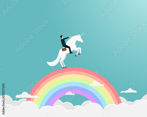 Businessman riding a unicorn on rianbow Wallpaper Mural