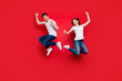 canvas print picture - Full length body size photo of cheerful positive crazy excited overjoyed ecstatic couple boyfriend girlfriend screaming wearing jeans denim jumping white t-shirt isolated vivid color background