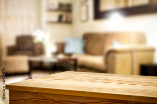 Obraz Wooden corner table background of free space for your decoration and blurred home interior  - fototapety do salonu