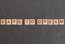 Dare To Dream Written With Game Tiles