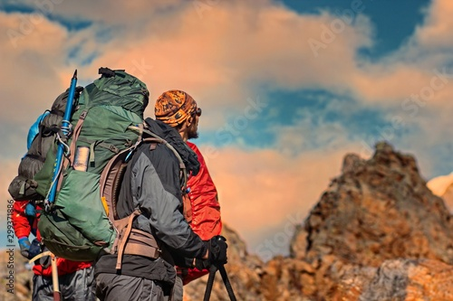 Foto auf Leinwand Dunkelbraun Man Traveler with big backpack mountaineering Travel Lifestyle concept lake and mountains on background, extreme vacations outdoor