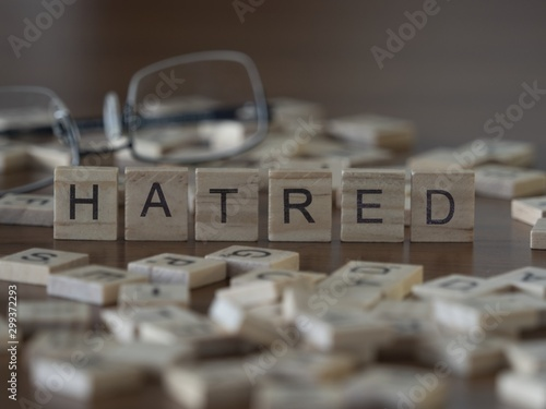 Photo The concept of Hatred represented by wooden letter tiles