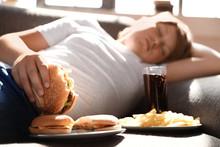 Overweight Boy Sleeping On Sof...