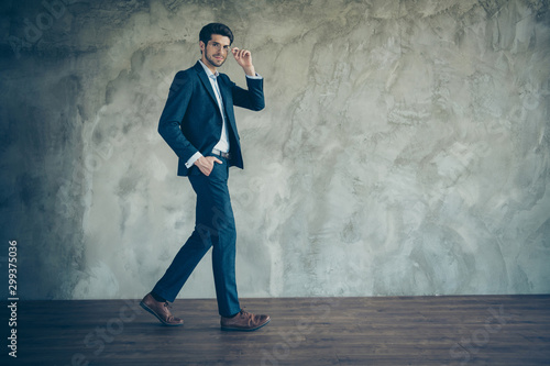 Fototapety, obrazy: Full length body size photo of cheerful positive confident man wearing eyeglasses with hand in pocket walking into empty space isolated grey color background