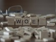 The concept of Woe represented by wooden letter tiles