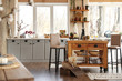 Leinwanddruck Bild - Stylish kitchen interior with wooden table and chairs