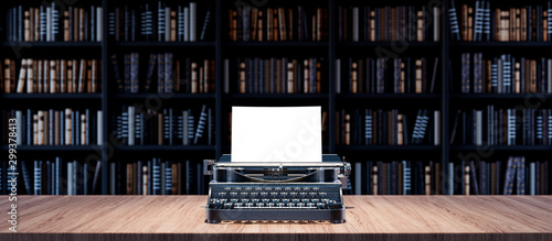 Journalist desk with old typewriter and Bookshelves in the library with old book Fototapet