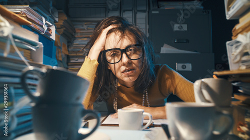 Vászonkép Stressed exhausted businesswoman working at night