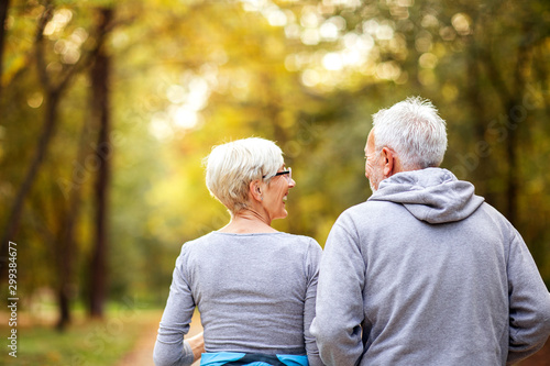 Fotografie, Obraz  Mature couple man and woman jogging in the park