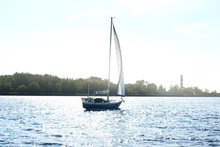 A Small Blue Sloop Rigged Yach...