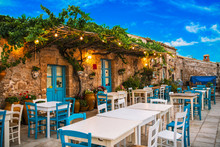 Famous Colorful Outdoor Cafe In The Most Beautiful Sicilian Village Marzamemi In Sicily, South Italy