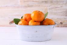 Peeled And Unpeeled Oranges