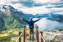 Man Enjoys The View With His H...