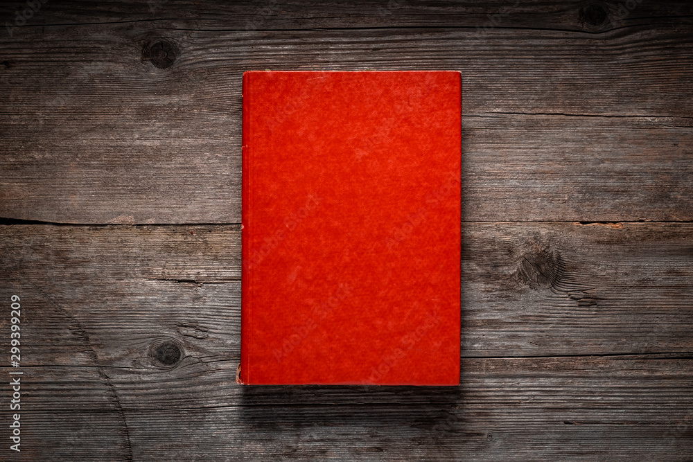 Fototapety, obrazy: Closed book on vintage wooden background.  Old book on the wooden table. Closed book with empty cover laying on wooden table.