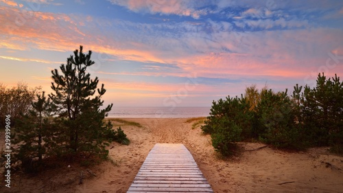 Keuken foto achterwand Strand Baltic sea shore and a road through the sand dunes