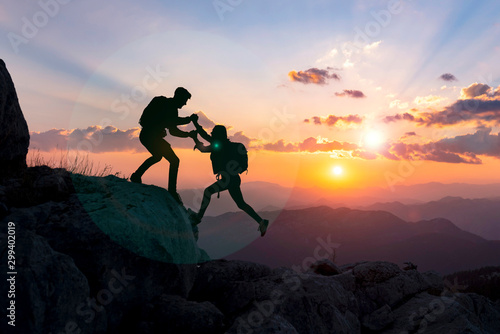 Obraz concept of male climber helping his girlfriend and moments of success together - fototapety do salonu