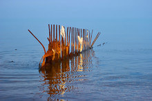 Old Rusty Breakwaters With Rag...