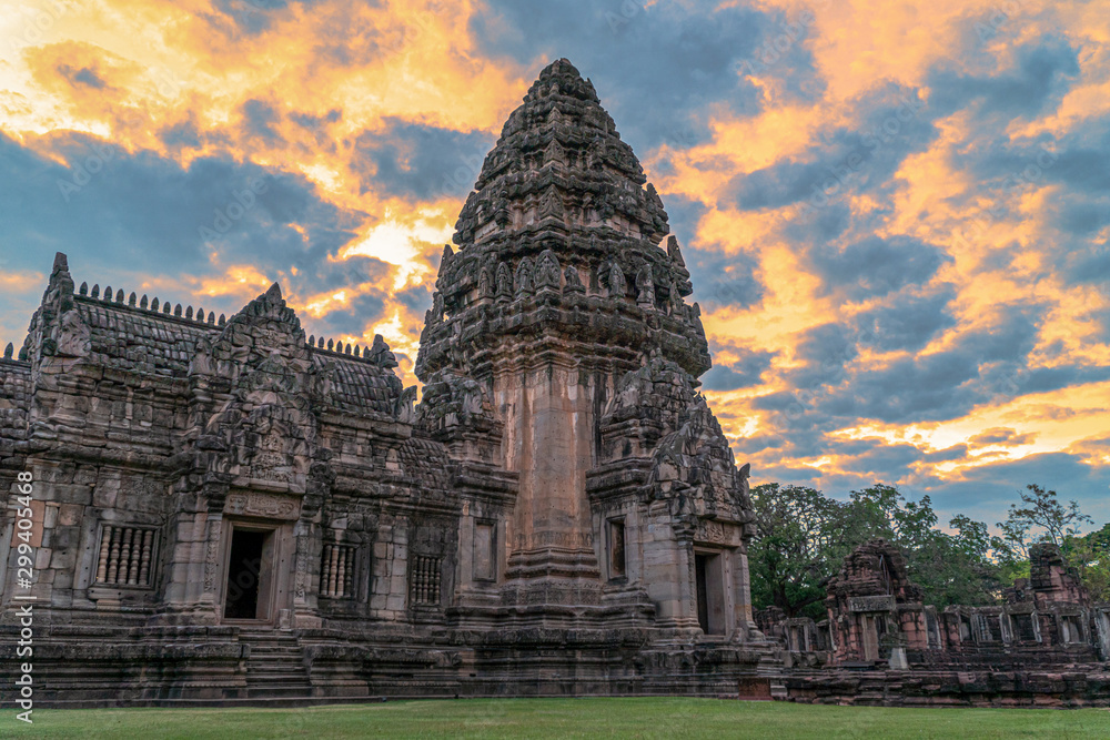 Fototapety, obrazy: The beautiful stone castle in Phimai historical park. Prasat Hin Phimai ancient Khmer Temple in Nakhon Ratchasima Thailand. Phimai stone castle built from laterite stone in Angkorian period arts.