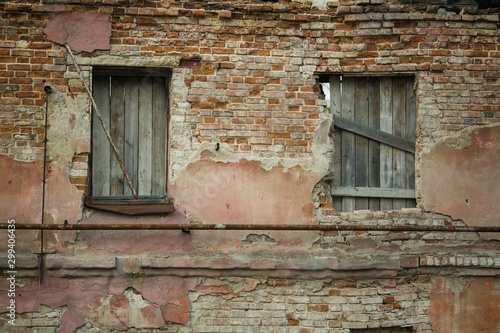 Facade of an abandoned old house.