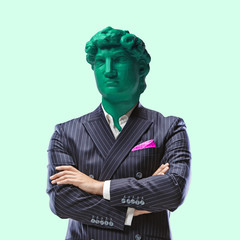 Business status. Office man headed by bright statue on green background. Head...