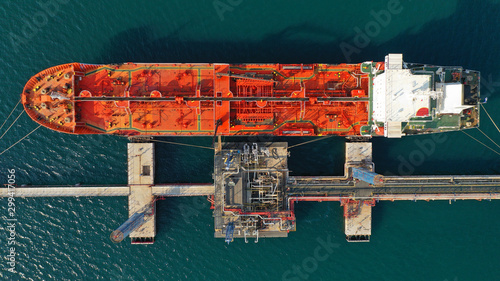 Aerial drone top view photo of industrial LPG gas and fuel container tanker dock Fototapeta