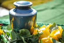 Urn With Yellow Roses, At An O...