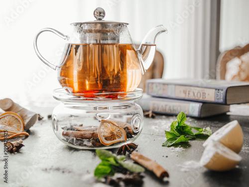 Fotografía Tea in a glass teapot on the light background