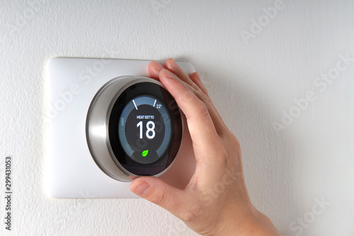 Fotomural  Smart Thermostat with a hand saving energy
