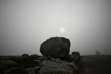 Boulder In Fog