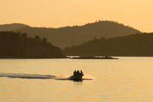 A Speedboat At Sunset On Lake Superior