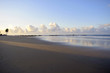 Deserted beach with blue sky at dawn