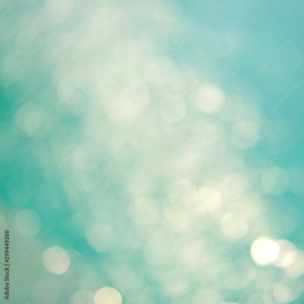 Fototapety, obrazy: Soft focus bokeh light effects over a rippled