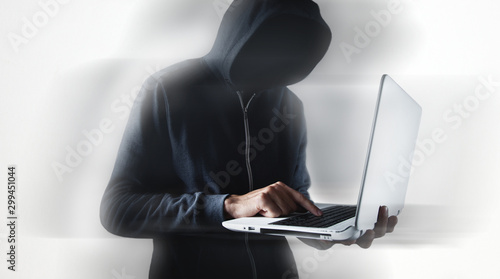 Fototapety, obrazy: Hacker with laptop. Computer crime.